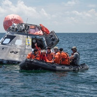 NASA Astronauts Practice Escaping from Orion Capsule at Sea