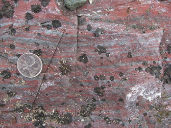 Jasper banded iron formation from the Nuvvuagittuq Supracrustal Belt in Québec, Canada, with grey ma...