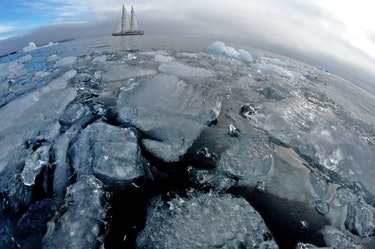 schooner sailing through ice in the water