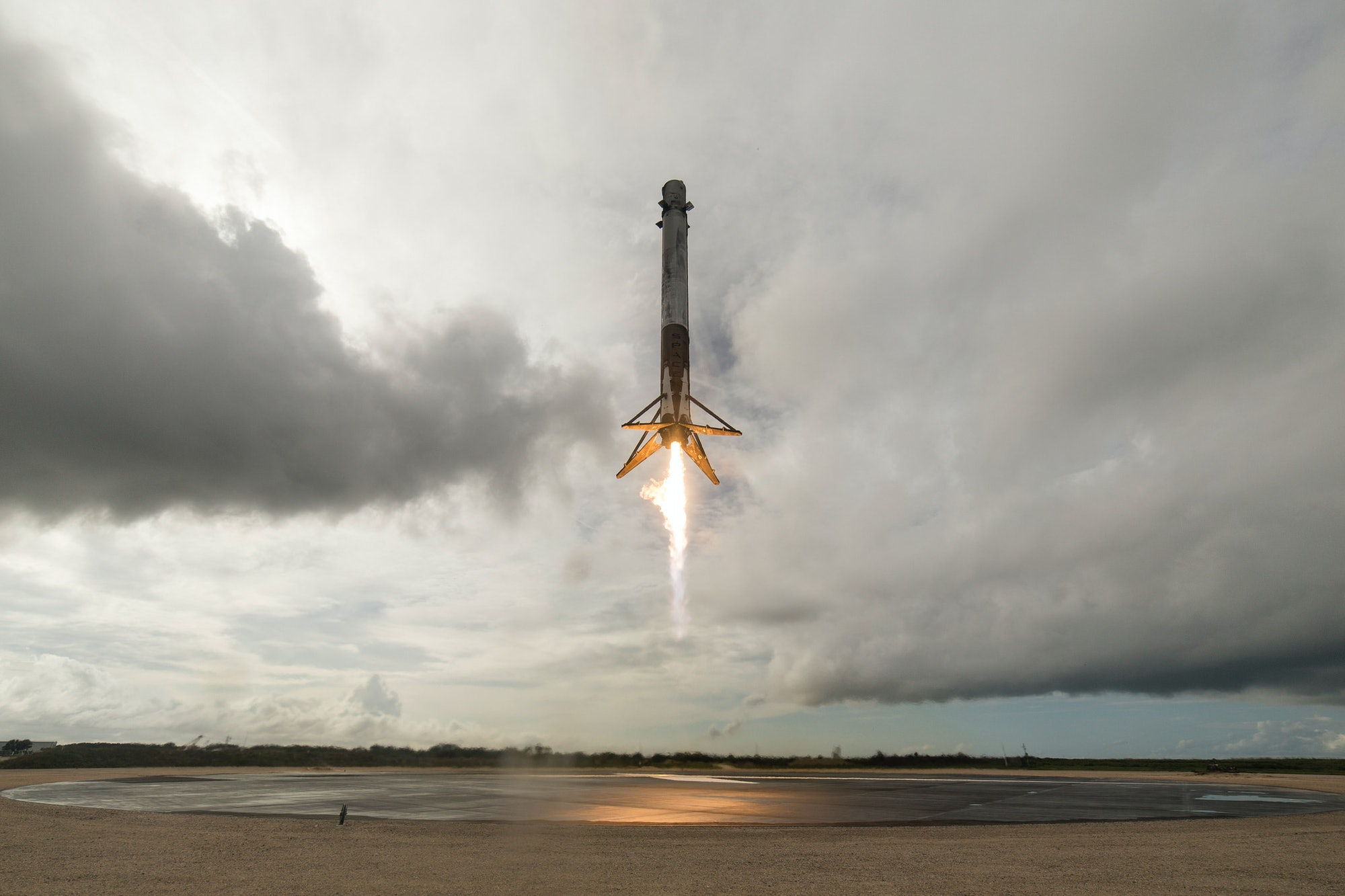The first stage of the Falcon 9 booster landing on June 3 at Kennedy Space Center.