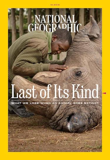 magazine cover shows man embracing elephant