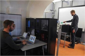 man robot lego research study participant setup laptop science