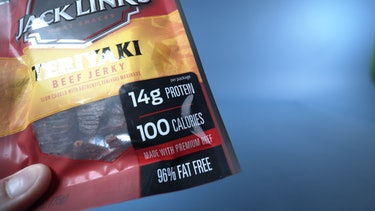 This bag of beef jerky notes its calorie count on the front, beneath its protein and above the advertisement that its contents are made with premium beef.