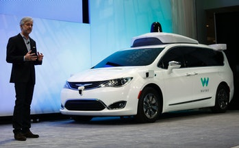 John Krafcik, CEO ofWaymo, debuts a customized Chrysler Pacifica Hybrid that will be used for Google's autonomous vehicle program.