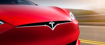 Tesla logo on a red Model S.