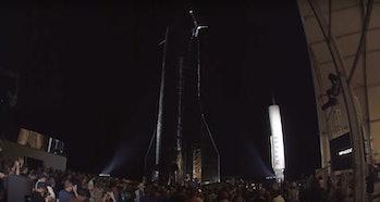 Elon Musk, standing underneath Starship Mk.1.