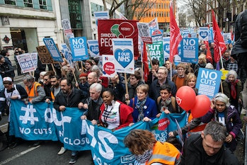 LONDON, ENGLAND - MARCH 04: Protesters carry banners and placards through central London during a demonstration in support of the NHS on March 4,2017in London, England. Thousands march from Tavistock Square to Parliament today for a demonstration against hospital closures,privatisationand cuts to the NHS. (Photo by Jack Taylor/Getty Images)