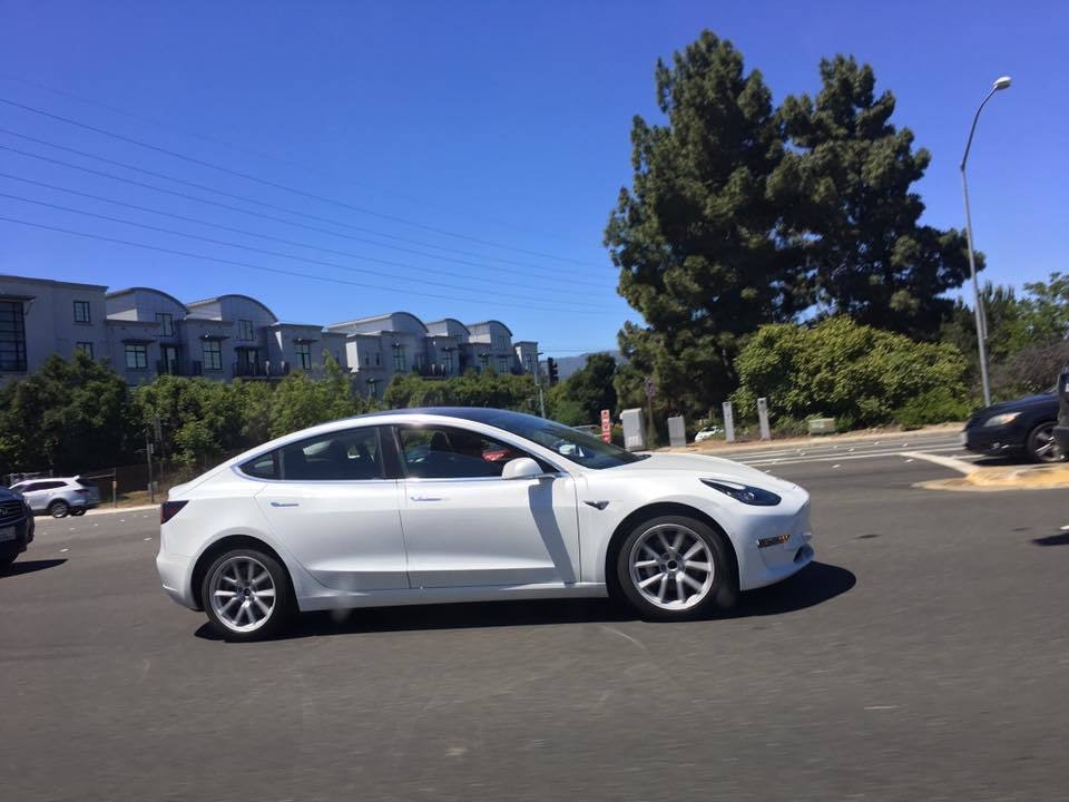 The white Model 3 in action.