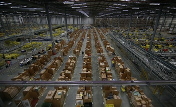HEMEL HEMPSTEAD, ENGLAND - DECEMBER 05: Parcels are prepared for dispatch at Amazon's warehouse on D...