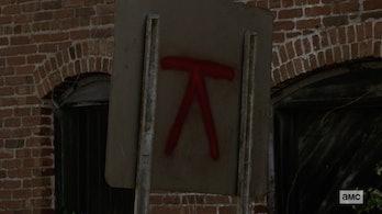 the walking dead symbol kingdom