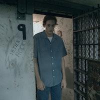 """'Castle Rock' Spoilers: 4 Reddit Theories About Bill Skarsgard's """"The Kid"""""""