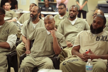 CHICAGO, IL - MAY 17: Inmates at the Cook County Jail watch as fellow inmates compete in a chess tournament online with inmates from the Prison Complex of Viana in Espirito Santo state in Brazil on May 17, 2017 in Chicago, Illinois. Inmates from Cook County won the tournament 4.5-3.5. This is the third time the jail has organized international chess competition for its inmates. The Cook County Jail, which houses more than 7,000 inmates, is the largest county jail in the country. (Photo by Scott Olson/Getty Images)