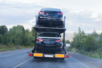 A car carrier making a delivery.