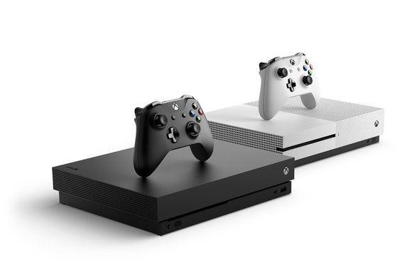 The Xbox One X next to the Xbox One S.