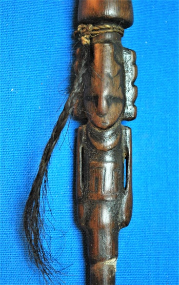This carved wooden tube was most likely used to sniff powdered A. peregrina or A. colubrina seeds, which contain the psychoactive compound bufotenine and trace amounts of DMT.