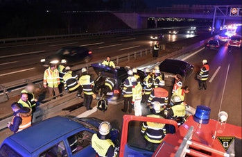 Firefighters in Munich, Germany, respond to the crash where a Tesla Model S stopped an out of contro...