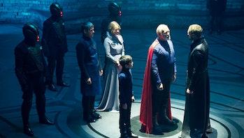 Superman'sgreat-great grandfatherVal-El (Ian McElhinney) faces a death sentence asCharys-El (Paula Malcomson), young Seg-El and hisfather (Rupert Graves) look on.