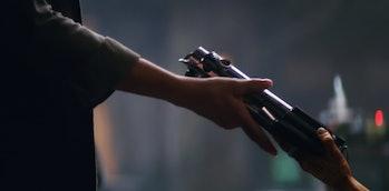 Maz hands Leia Luke's first lightsaber in the trailer for 'The Force Awakens.'