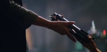 Maz hands Leia Luke's first lightsaber in the trailer for 'The Force Awakens.'