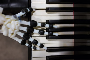 robot hand playing the piano
