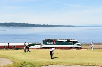 UNIVERSITY PLACE, WA - JUNE 15: An Amtrak train passes the 16th green during a practice round prior to the start of the 115th U.S. Open Championship at Chambers Bay on June 15, 2015 in University Place, Washington. (Photo by Harry How/Getty Images)