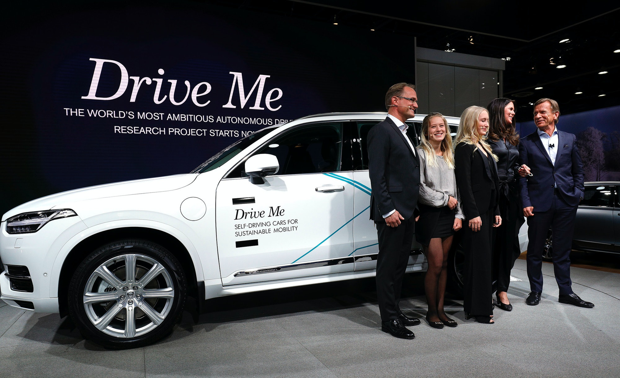 DETROIT, MI - JANUARY 9: Hakan Samuelsson (R), President and CEO, Volvo Car Group, stands with the Hain family from Sweden next to the autonomous Volvo vehicle they will be testing at the 2017 North American International Auto Show on January 9,2017in Detroit, Michigan. Approximately 5000 journalists from around the world and nearly 800,000 people are expected to attend the NAIAS between January 8th and January 22nd to see the more than 750 vehicles and numerous interactive displays. (Photo by Bill Pugliano/Getty Images)