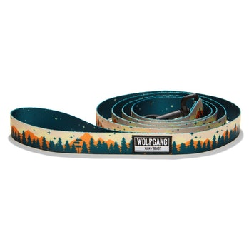 A dog leash with mountains and green trees.