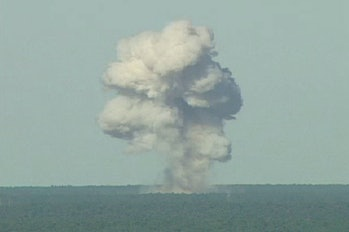 ELGIN AIR FORCE BASE, FL - NOVEMBER 21: In this U.S. Air Force handout, a GBU-43/B bomb, or Massive Ordnance Air Blast (MOAB) bomb, explodes November 21, 2003 at Eglin Air Force Base, Florida. MOAB is a 21,700-pound that was droped from a plane at 20, 000 feet. (Photo by USAF via Getty Images)