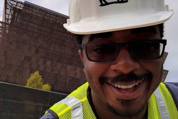 Project Griot lead Travis McPhail in front of the National Museum of African American History and Culture.