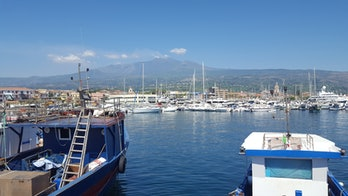 FromRiposto Harbor, you can see theunstable southeastern flank of Mount Etna.