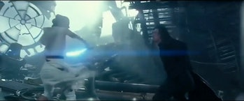 Does Rey aim to slash a defenseless Kylo Ren in the chest here?