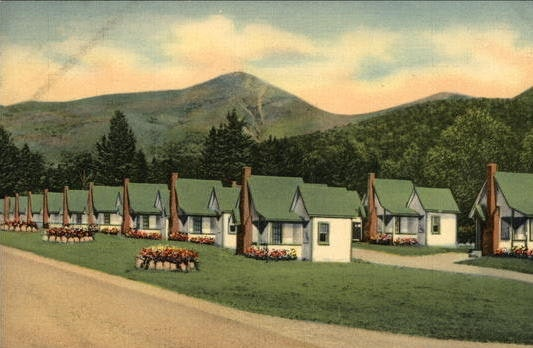 A postcard depicts the English Village East in New Hampshire.