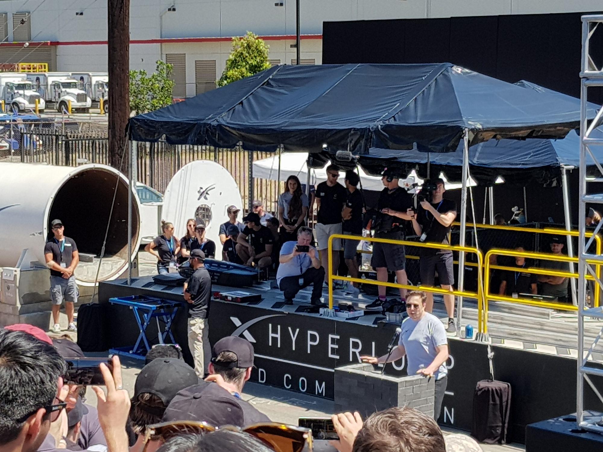 Elon Musk at the podium.