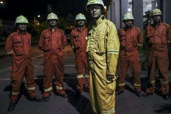 Fire fighters stand for photograph at the Vadinar Refinery complex operated by Nayare Energy Ltd.
