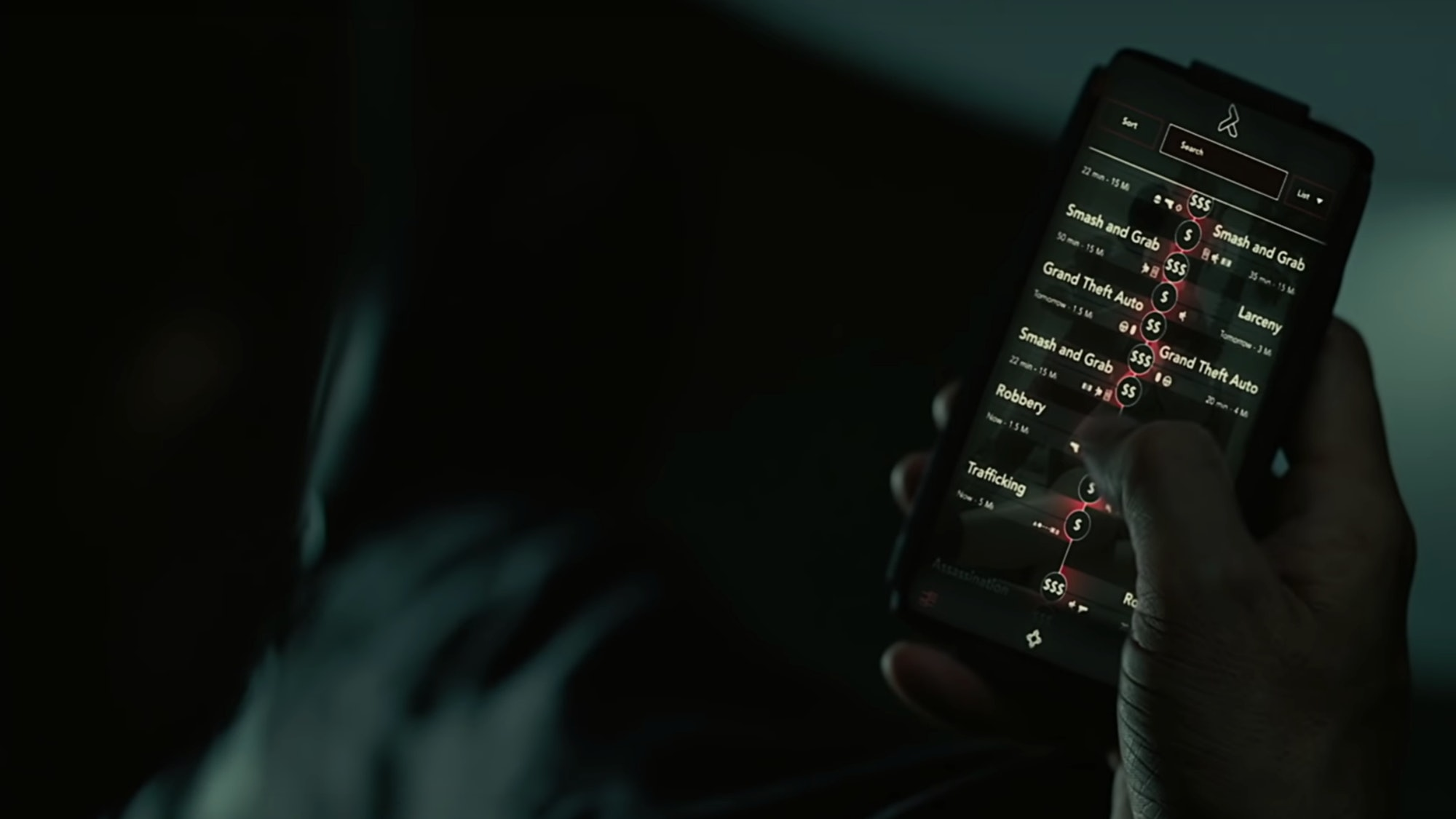 Still from Westworld III with phone full of criminal activity