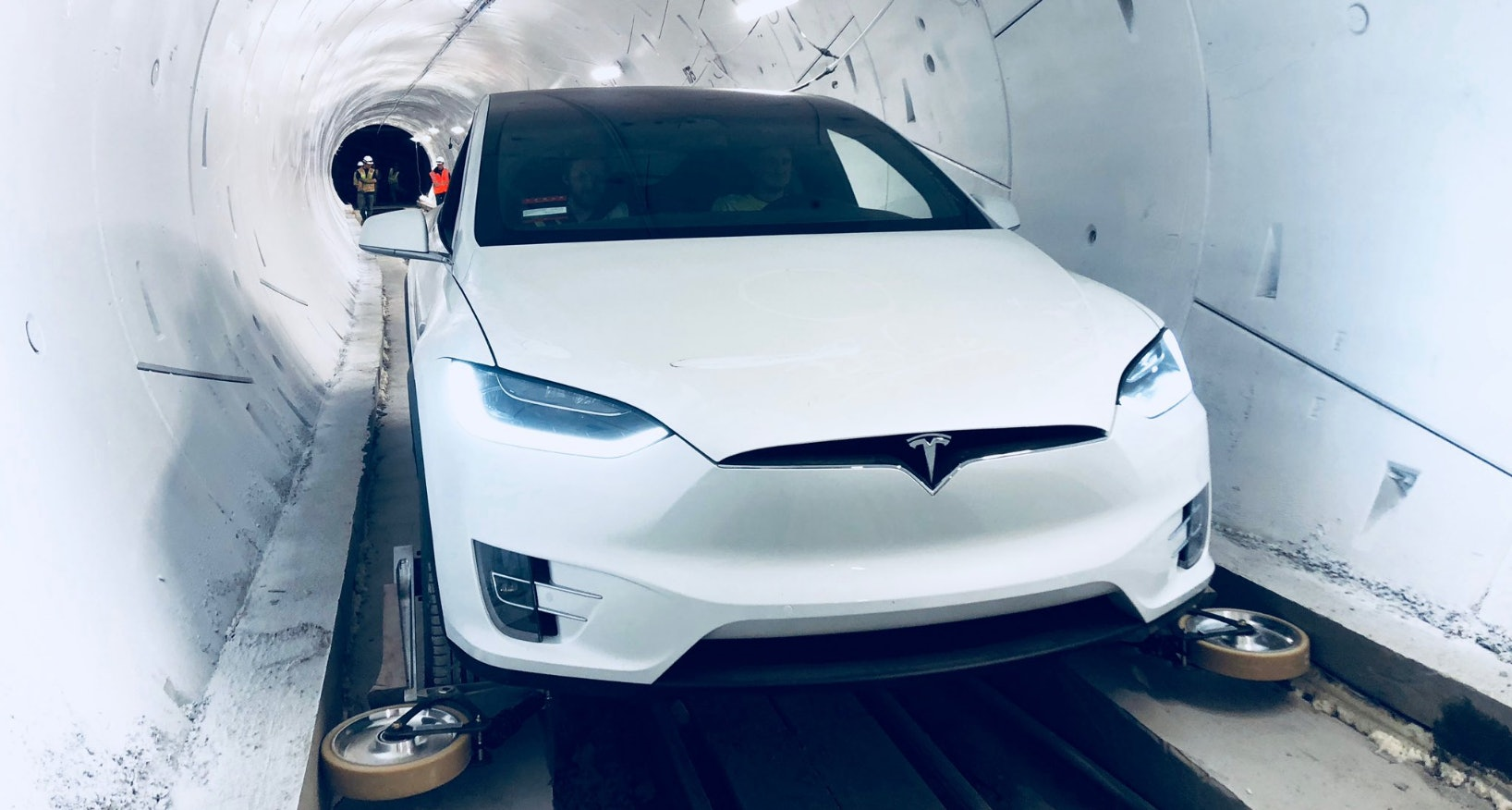 A Tesla Model X, fitted with the necessary guide wheels, inside The Boring Company's tunnel.