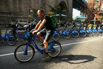 A man rides a bike through Dumbo on October 4, 2013 in the Brooklyn borough of New York City. A group of five prominent properties in Dumbo owned by the Jehovah's Witnesses have recently been sold and are slated to become part of a complex that will be converted into a center for technology companies. The five buildings, which will become part of the larger Brooklyn Tech Triangle, were sold to Jared Kushner, the Kushner Cos. CEO, and RFR for a reported $375 million deal. What was until recently a sleepy former manufacturing hub with cobblestone streets and derelict old factories has become one of the trendiest locations in New York City.