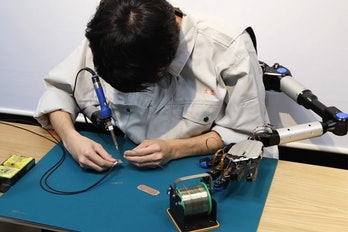 man metalimbs robot arms robotic limb circuit soldering iron solder