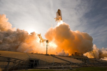 NASA space shuttle lifting off