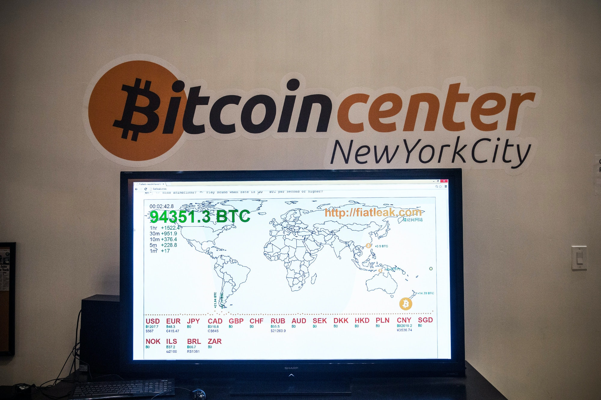 NEW YORK, NY - FEBRUARY 26: A television screen displays variousbitcoinrates at Bitcoin Center NYC during a class on the basics of Bitcoin and how to trade the digital currency on February 26,2014in New York City. The recently opened center offers a physical space for people to trade digital currencies, including bitcoin. Bitcoin Center NYC also offers classes for people interested in learning about digital currencies. (Photo by Andrew Burton/Getty Images)