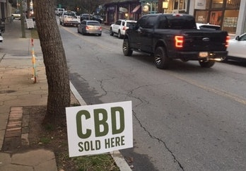 A sign outside a market in Atlanta on Jan. 18, 2019 advertising the availability of CBD.