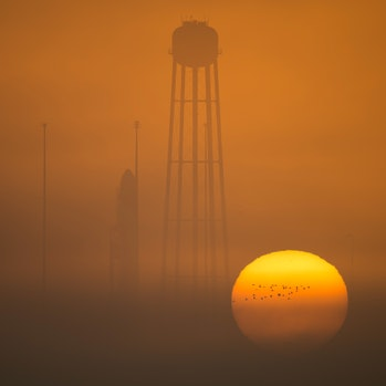 The Orbital ATK Antares rocket, with the Cygnus spacecraft onboard, stands on launch pad, waiting to take flight.