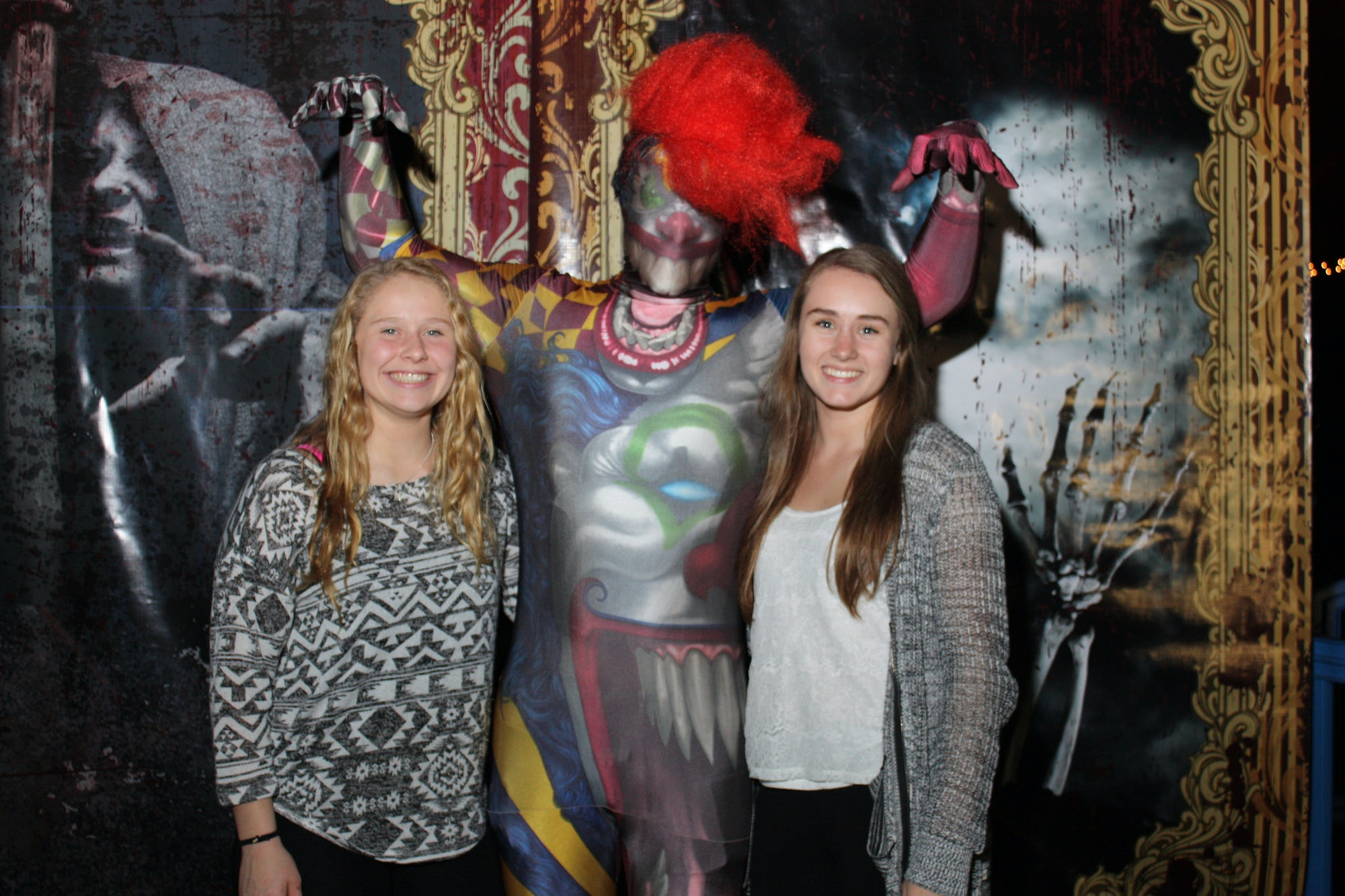 Friends take photo with actor at Walk In the Dark interactive horror-theater