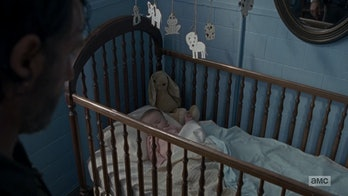 Baby Gracie has a stuffed rabbit tucked in her crib when Rick finds her.
