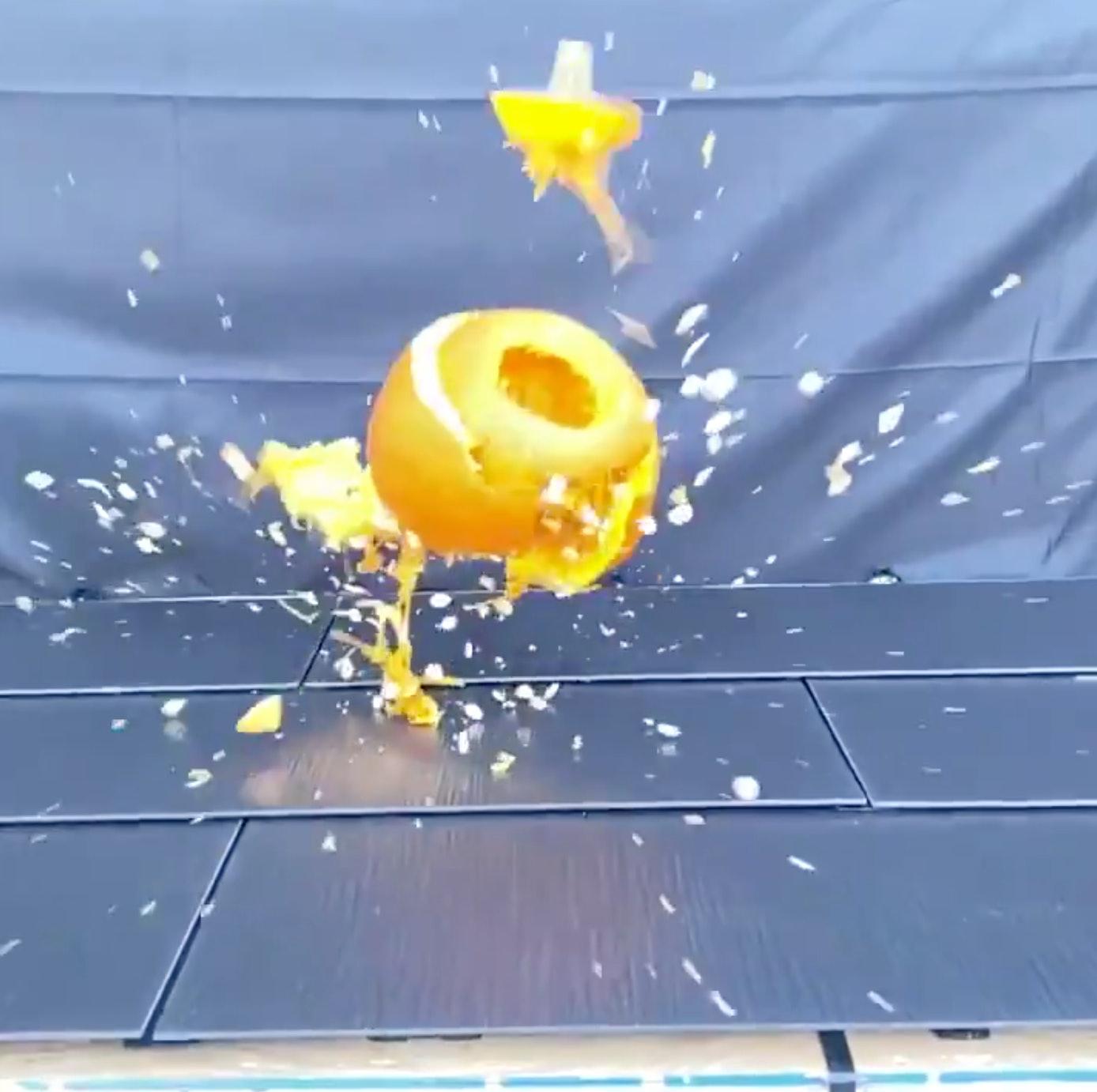 Tesla Solar Roof getting hit by a pumpkin.