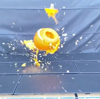 Tesla Solar Roof getting hit by a pumpkin.