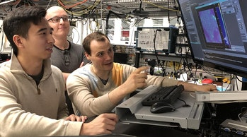 (From left) graduate students Kevin Miao, Chris Anderson, and Alexandre Bourassa conduct quantum experiments on their silicon carbide.