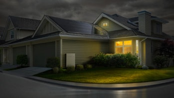 A Tesla Powerwall as it appears on the side of a residential home in this photo on the Tesla website. This is what consumers want, but a survey of solar customers shows that most solar installers can't offer it.