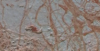 This enhanced-color view from NASA's Galileo spacecraft shows an intricate pattern of linear fractures on the icy surface of Jupiter's moon Europa.