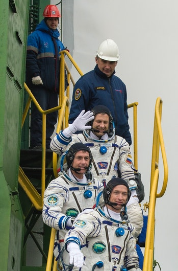 Expedition 49 flight engineer Andrey Borisenko of Roscosmos, flight engineer Shane Kimbrough of NASA, and Soyuz commander Sergey Ryzhikov of Roscosmos, climb the ladder to the elevator as they prepare to board the Soyuz MS-02 rocket for launch, Wednesday, Oct. 19, 2016 at the Baikonur Cosmodrome in Kazakhstan. Kimbrough, Borisenko, and Ryzhikov will spend the next four months living and working aboard the International Space Station.